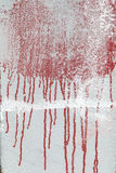 Red paint on a white background Royalty Free Stock Image