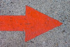 Red Painted Arrow on Concrete Royalty Free Stock Images