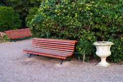 Red painted bench in Royal Gardens. Or Giardinetti Reali on Riva degli Schiavoni adjacent to St Marks Square Venice stock photography