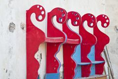 Red-painted boards arranged on a wall Royalty Free Stock Images