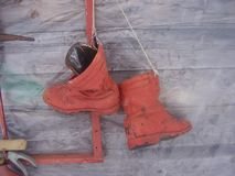 red painted boots on a fire shield royalty free stock photography