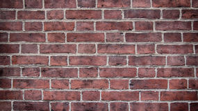 Red painted brick wall. Architecture vibrant background Royalty Free Stock Photography