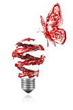 Red painted butterfly flying around red white light bulb Stock Photo