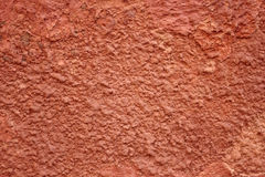 Red painted cracked wall Stock Photography