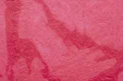 Red painted crepe paper background. Texture stock photos