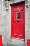 Red painted door and bollards Stock Images