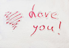 Red painted heart and Declaration of love stock photography