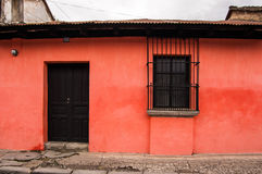 Red painted house exterior. Typical painted colonial style house in UNESCO World Heritage Site, Antigua, Guatemala Stock Images