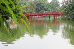 The red painted Huc Bridge at Hoan Kiem lake in Hanoi, Vietnam. - Series 2 Royalty Free Stock Photos
