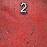 Red painted metal with rust stains and water drops Royalty Free Stock Image