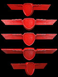 Red painted metal wings set isolated on black background Stock Photography