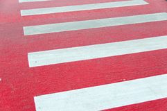 Red painted pedestrian crossing . Stock Image