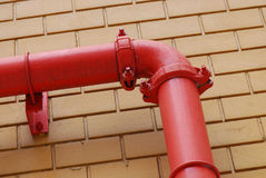 Red Painted Pipe Stock Photo