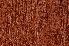 Red painted plastered wall Stock Photography