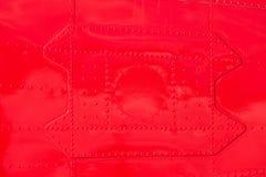 Red painted riveted metal airplane fuselage skin Royalty Free Stock Photos