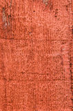 Red painted rough wooden siding board Stock Image