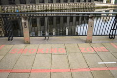 Red painted smoking zone in a short walkway bridge Royalty Free Stock Image