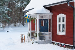 Red painted Swedish wooden house in a wintry landscape Stock Image