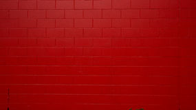 Red painted Wall. I saw this car parking space where one of the perimeter walls are painted bright red and the other wall is blue. The day was sunny when I took Royalty Free Stock Photography