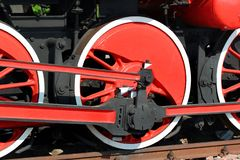Red painted wheels of a steam locomotive stock images