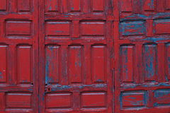Red painted wooden door frame detail background Stock Images