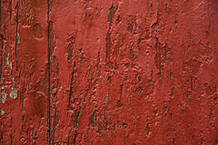 Red painted wooden panel, background, wallpaper. Colorfully painted wooden panel, representing a decorative, red and white background, with textured effect for Royalty Free Stock Photography