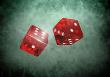 Red Pair of dice on green vignette Stock Photo