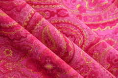Red paisley background, cloth texture Stock Image