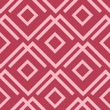 Red and pale pink geometric ornament. Seamless pattern Stock Photos