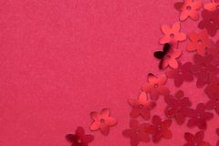 Red palettes in the form of flowers on a red background. Red palettes in the form of flowers on a red background, a festive concept.  Place for text stock photos