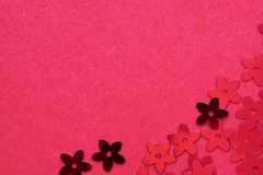 Red palettes in the form of flowers on a red background. Red palettes in the form of flowers on a red background, a festive concept.  Place for text royalty free stock photos