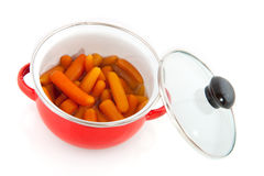 Red pan with carrots Stock Image