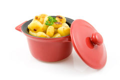 Red pan with fresh baked potatoes Stock Images