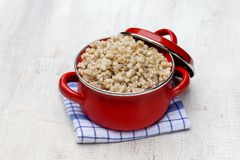 Red pan with wheat porridge - traditional meal in Ukraine, Belarus and Russia Stock Photography