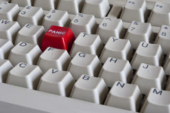 Red Panic button. Computer keyboard with red panic button Stock Image