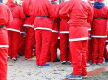 Red pants of people dressed as Santa Claus during the foot race Stock Photography