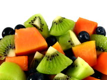 Red Papaya, Kiwi Fruit and Blueberry Fruit Salad. Macro photo of tropical fruit salad Royalty Free Stock Images