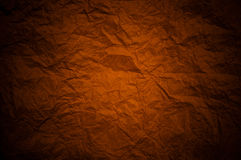 Red paper background with dark creased patterns an Stock Photos