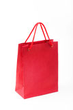 Red paper bag closeup  on white background Royalty Free Stock Photos