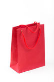 Red paper bag closeup  on white background Royalty Free Stock Photography