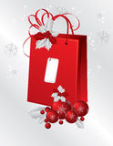 Red paper bag decorated with holly berry Royalty Free Stock Image