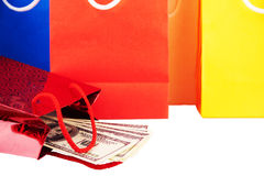 Red paper bag with dollars. Isolated Stock Image