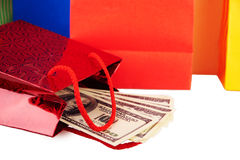 Red paper bag with dollars. Isolated Stock Photos