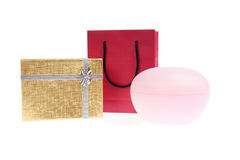 Red paper bag and gold gift box with bow Stock Images