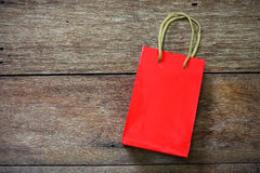 Red Paper bag on a wooden texture Stock Photos