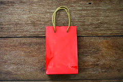Red Paper bag on a wooden texture Royalty Free Stock Photo