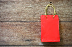 Red Paper bag on a wooden texture Royalty Free Stock Image