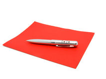 Red paper and ball pen Stock Images
