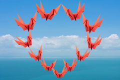 Red paper birds in heart shape Royalty Free Stock Photo