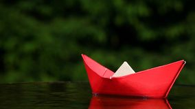 Red paper boat autumn garden footage hd. Day light stock footage
